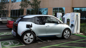 EVgo and BMW partner to bring ChargeNow DC Fast electric vehicle charging program to 25 cities nationwide. EVgo Network will have more than 600 50 kW DC Fast Combo chargers in next 2 years. BMW i3 drivers get 2 years free charging with the purchase of their vehicle (PRNewsFoto/EVgo)